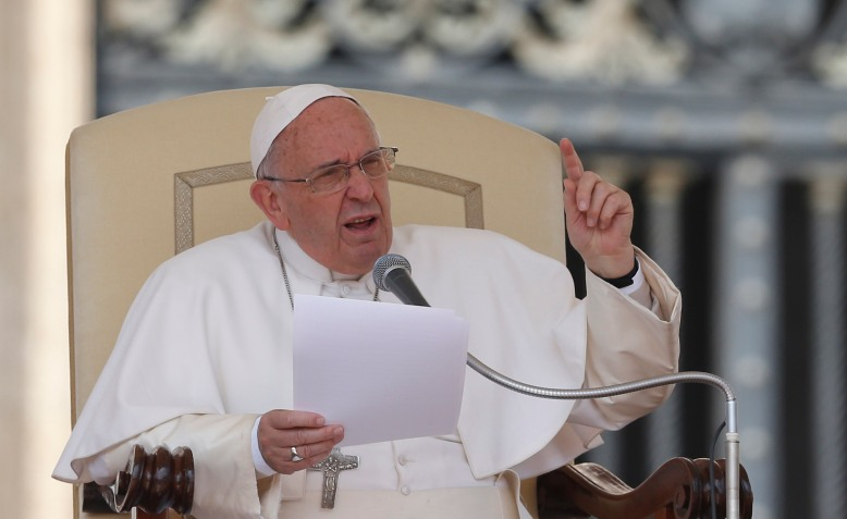 Pope Francis speaks as he leads his general audience in St. Peter's Square April 29. (CNS/Paul Haring)