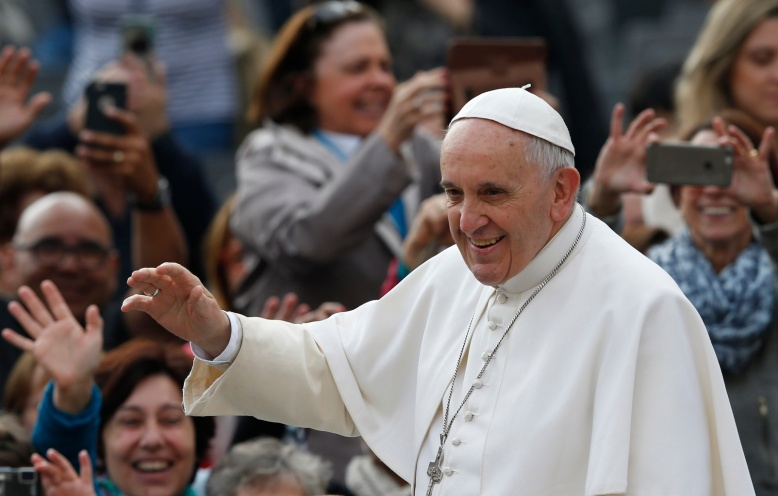 Pope Francis greets the crowd as he arrives to lead his general audience in St. Peter's Square at the Vatican April 29. (CNS/Paul Haring)