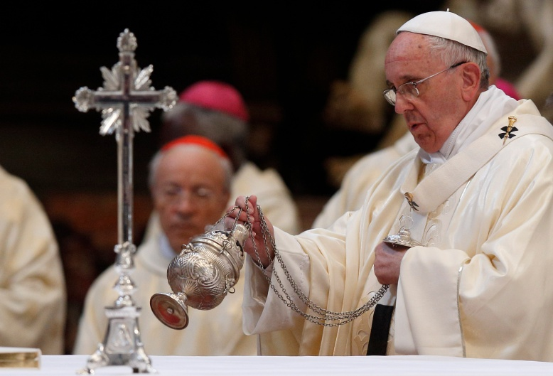 Pope Francis uses incense as he celebrates a Mass for the opening of the general assembly of Caritas Internationalis in St. Peter's Basilica. (CNS/Paul Haring)